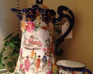 Asian style hand painted teapot and cup