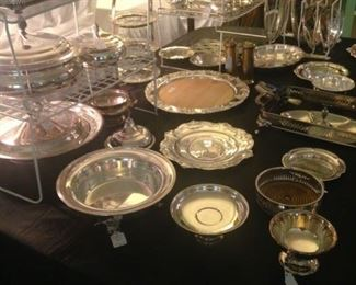 Some of the many silver plate serving pieces