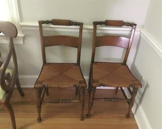 Set of four rush bottom antique Hitchcock chairs.