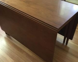 Wonderful heavy thick plank drop leaf table.