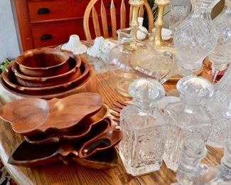 a collection of monkey pod wood bowls, trays and decorative pieces