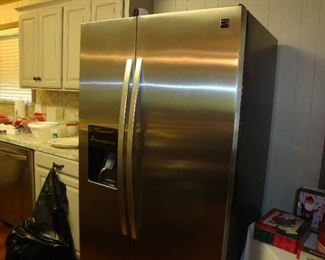 Kenmore refrigerator with ice and water in the door