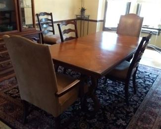Walnut dining table with six chairs and two leaves