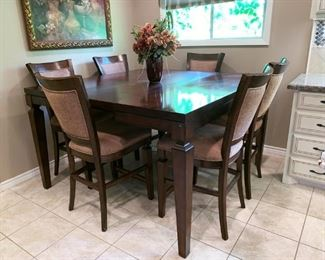 Lovely Pub Height Dining Table with Hidden Leaf Extended, Six Chairs. 5' X 5' with Leaf
