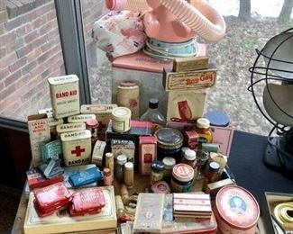 Pink elephant hair dryer, vintage medicine cabinet and ladies' vanity items.