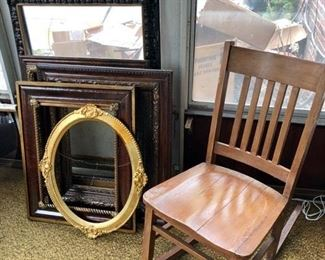 Large antique wooden picture frames & Mission style rocker.