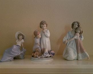 A collection of Lladro figurines.