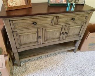 This is a contemporary Sideboard/Buffet/Cabinet...perfect for any home.