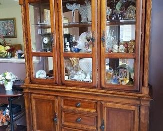 This is one wonderful piece of furniture..a big wow! on this one! Curio/China Cabinet...with lighting.