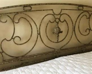 Detail on ornate metal frame king-size bed w/mattress