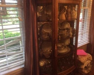 Oak curved glass china cabinet with three wood shelves