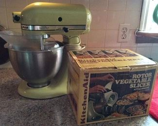 """Vintage"" kitchenaid mixer with attachments.  Still in use making pound cakes!  Works great!"