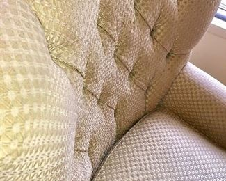 Creamy colored accent chair with ottoman