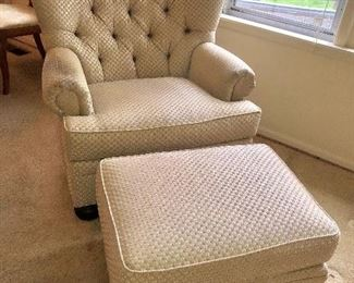 Cream colored accent chair with ottoman