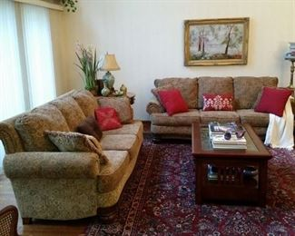 Two matching sofas in excellent condition