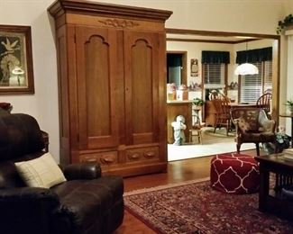 The large antique armoire quickly comes apart to make moving easy.