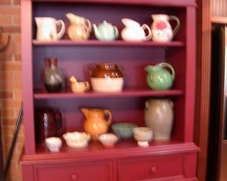 Great pottery pieces ( cabinet not for sale )
