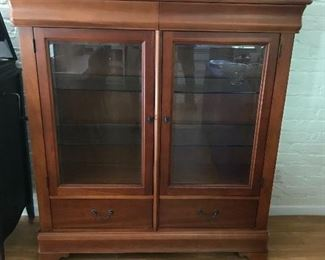Beautiful small china cabinet (lighted).  Will fit in any room!