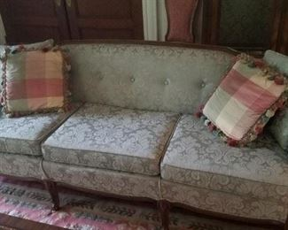 Antique sofa in excellent condition.  Recently reupholstered.
