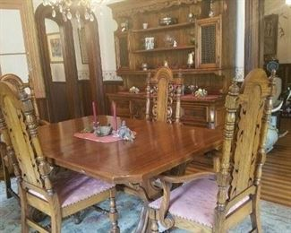 Dining room table with 6 side chairs.  Three leaves and table pads