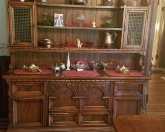 Large hutch with several drawers and shelves.