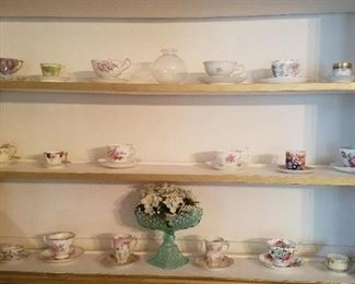 Various antique tea cups and saucers