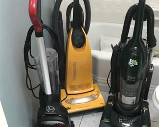 THREE TOP NOTCH VACUUM CLEANERS AND SCRUBBER