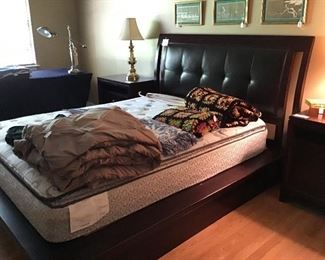 Very nice Queen size bed with faux leather headboard