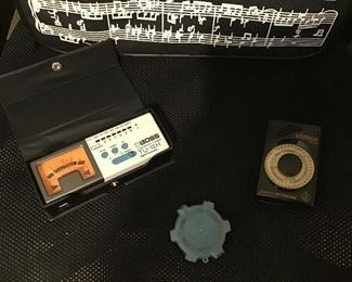 Auto tuner, pitch pipe and small metronome.