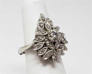 #41: 14k White Gold Diamond Ring, 6.2g Weighs approx 6.2g, size 4.5 with ring sizer on, center diamond is approx 1/8ct