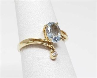 #49: 14k Gold Ring with Center Stone and Accent Diamond, 1.7g Weighs approx 1.7g, size 5