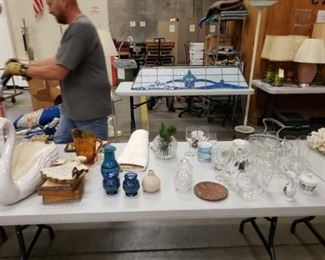 #1110: Approximately 50 miscellaneous estate items Estate items include ceramic planter, brass clock, picture, salt and pepper shakers, vases, ceramic hot pad, different glasses, coffee mugs and more. Please view all photos