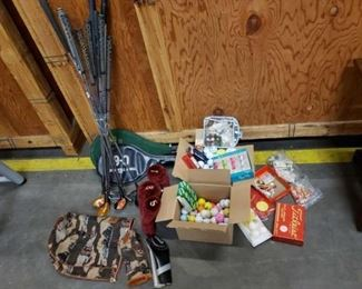 #1600: Mixed Golf Clubs, Driver Covers, 2 Racquets, 2 Boxes of Golf Balls and Tees Mixed Golf Clubs, Driver Covers, 2 Racquets, 2 Boxes of Golf Balls and Tees