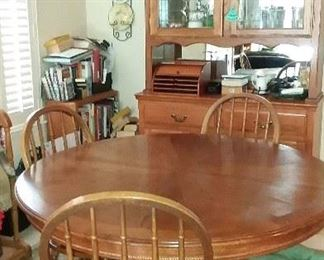 This oak table set has one leaf and four chairs in great shape $150  China cabinet $100