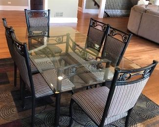 $500 obo- Glass and Metal Dining Table set with upholstered 6 chairs.  Leaf Design.  A few scratches on glass top.  Otherwise in great condition! table 42dx72wx30h  chairs 30.5hx18wx18d seat 19h