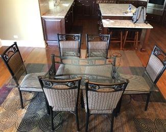 $500 obo Glass and Metal Dining Table set with upholstered 6 chairs.  Leaf Design.  A few scratches on glass top.  Otherwise in great condition! table 42dx72wx30h  chairs 30.5hx18wx18d seat 19h