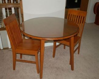 Round small dining table with two chairs