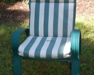 One of 6 cushioned outdoor chairs