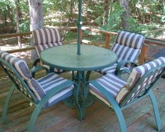 Table with 4 chairs and umbrella