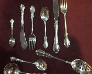 Service for 12 four piece place setting plus serving pieces