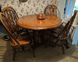 $180  Round, oak table with chairs