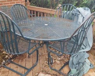 $100  Round, metal patio table with four chairs