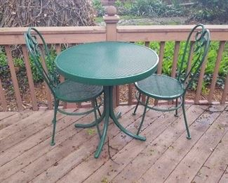 $50  Small, green metal table with two chairs