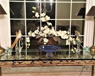 GORGEOUS heavy glass top table with antique wrought iron base.  Pair of vintage buffet lamps, Orchid arrangement, and art glass.