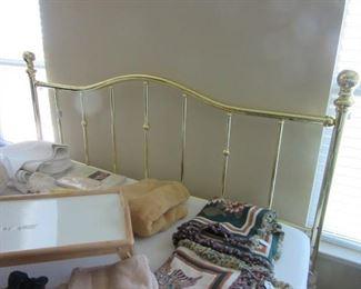 Brass king-sized headboard with pads, skirts, etc.