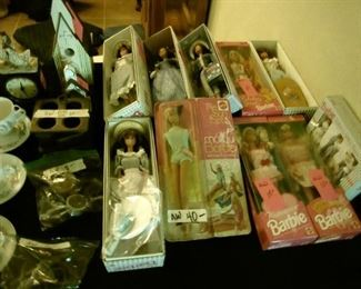 Barbies, note the one in the center front is in the original package from the  60's!