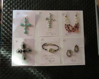 Beautiful cross pendants, vintage Lady Elgin watch, & other stone earrings.