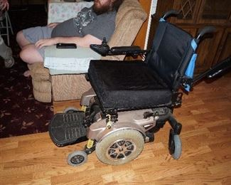Power chair with lift seat. Includes motorized lift that installs in van.