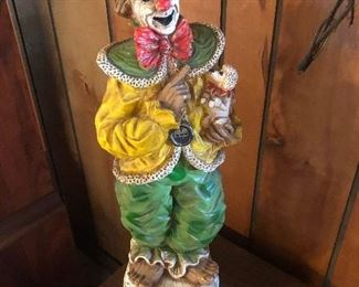 Clown statue with tiny poodle