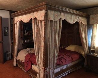 Covered four poster canopy bed